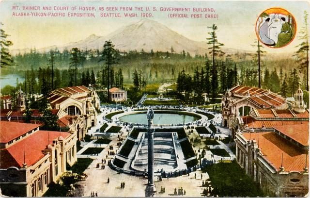"colorized photo from old postcard showing aerial view of central plaza, bordered by red-roofed buildings, with cascading pools to large round pool, all centered on-axis with a distant view to Mt. Rainier. Text on postcard reads, ""Mt. Rainier and Court of Honor, as seen from the US Government Building, Alaska-Yukon-Pacific Exposition, Seattle, Wash., 1909. (Official Post Card)"""