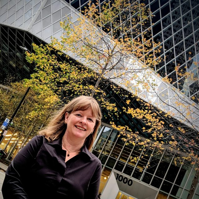 head and shoulders shot of author Jennifer Ott in front of Seattle's downtown library.