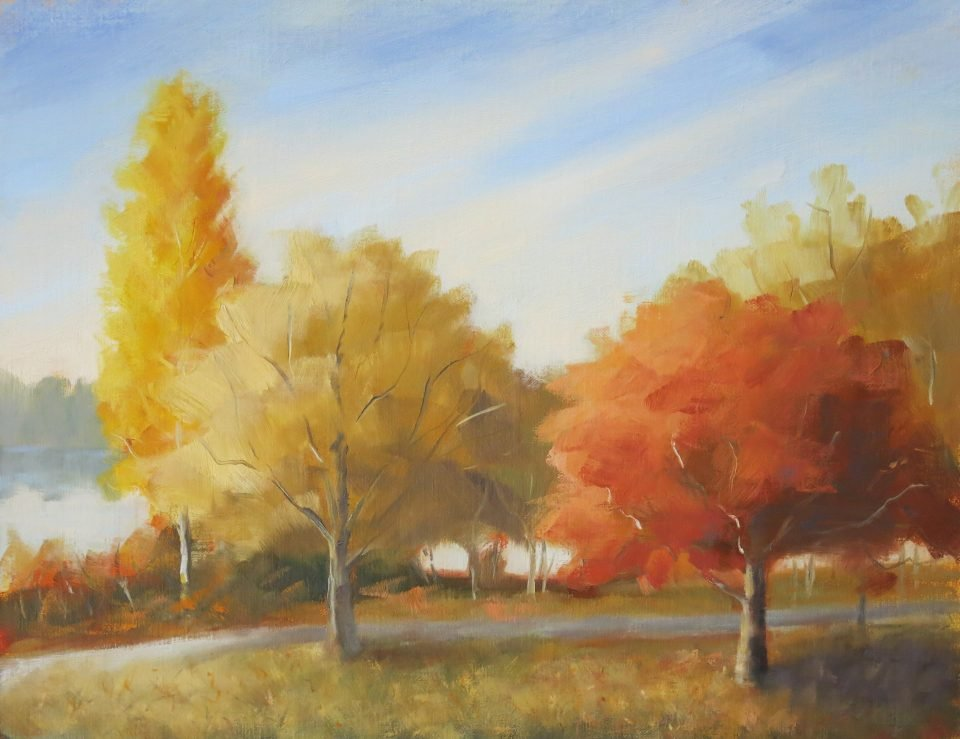 painting of yellow and orange trees in fall, lake and pathj in background
